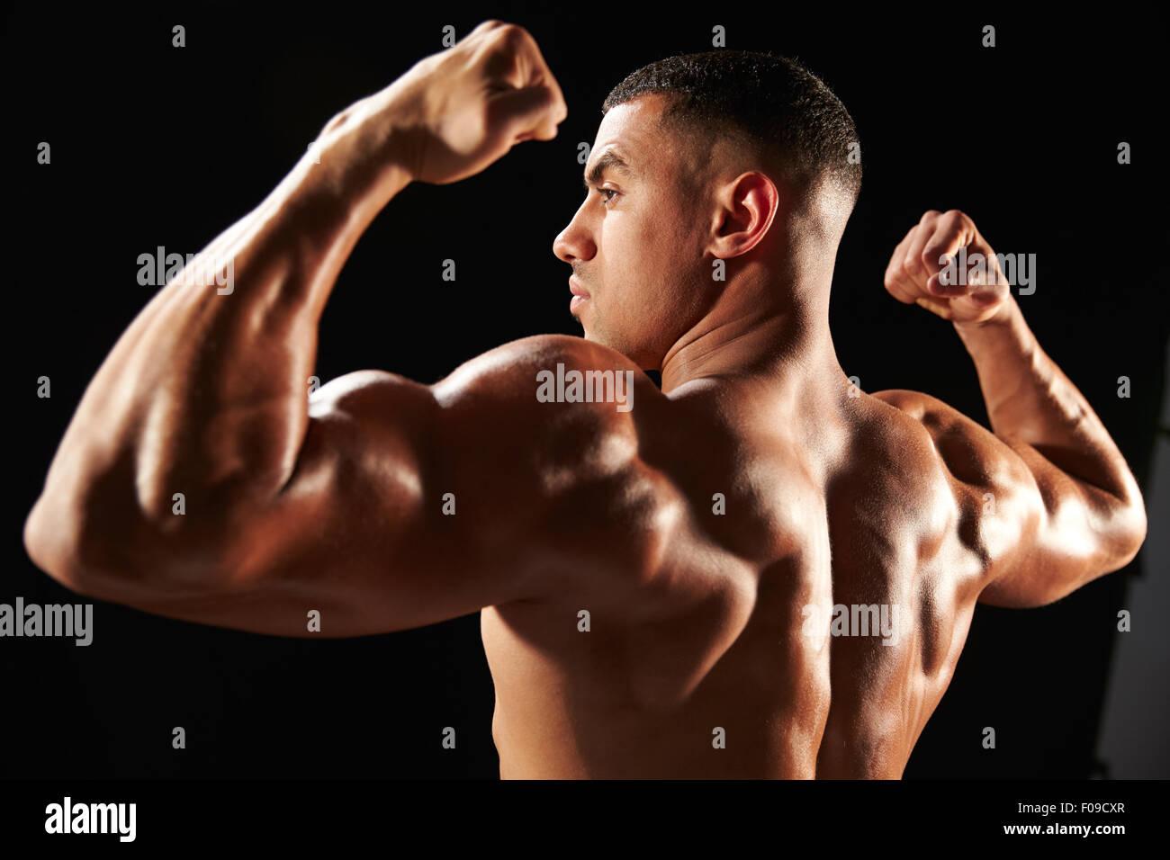 flexing muscles stock photos