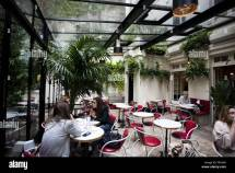 People Sitting In Patio Of Hotel Amour Paris France