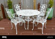 White Cast Iron Garden Table And Chairs In