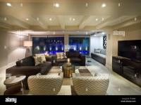 Beautiful living room with big windows, couple of sofas
