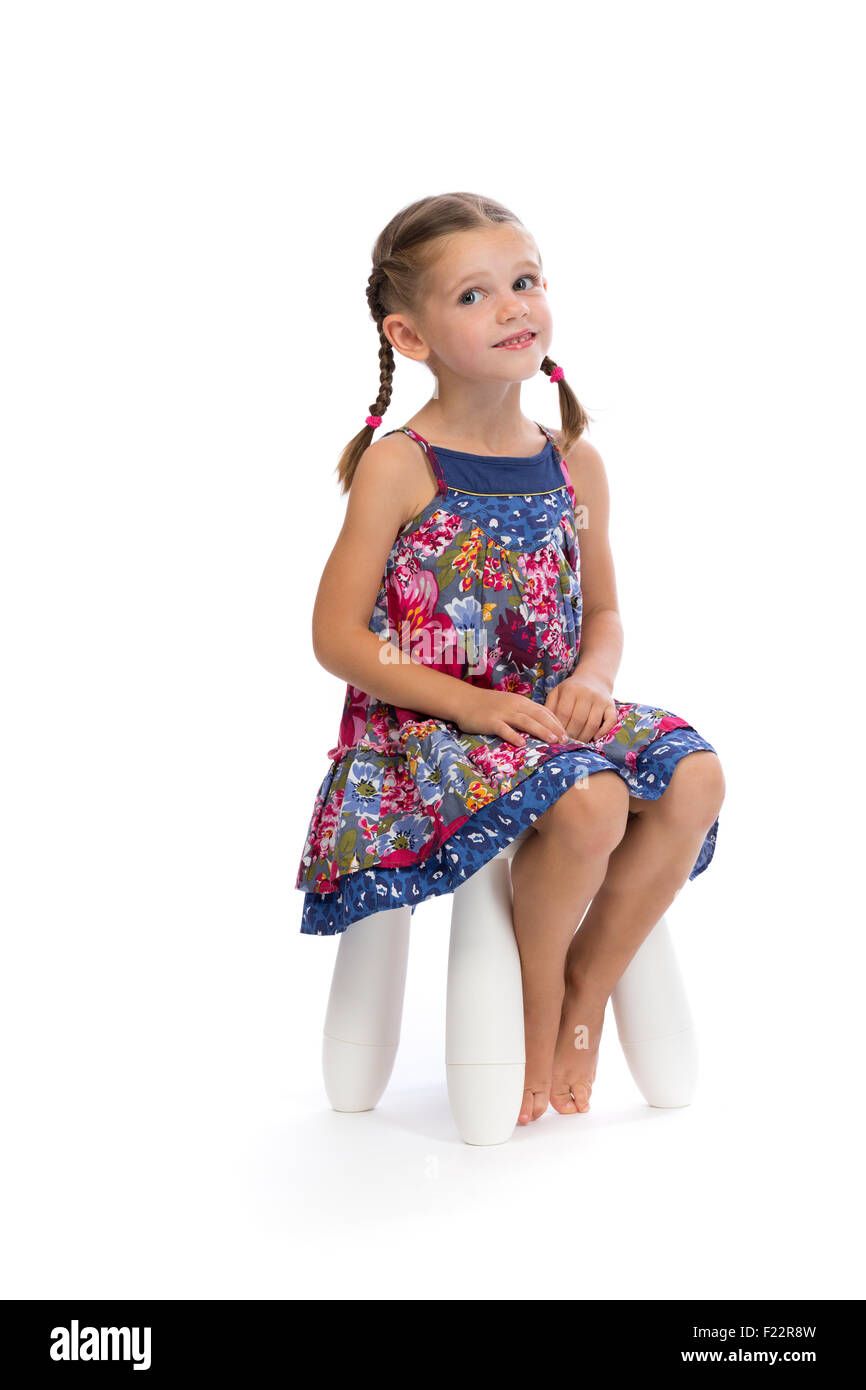 little girl chairs hanging chair urban outfitters in a colored dress on the studio and shy isolate white