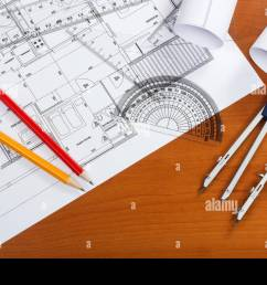 architectural plans pencils and ruler on the desk [ 1300 x 956 Pixel ]