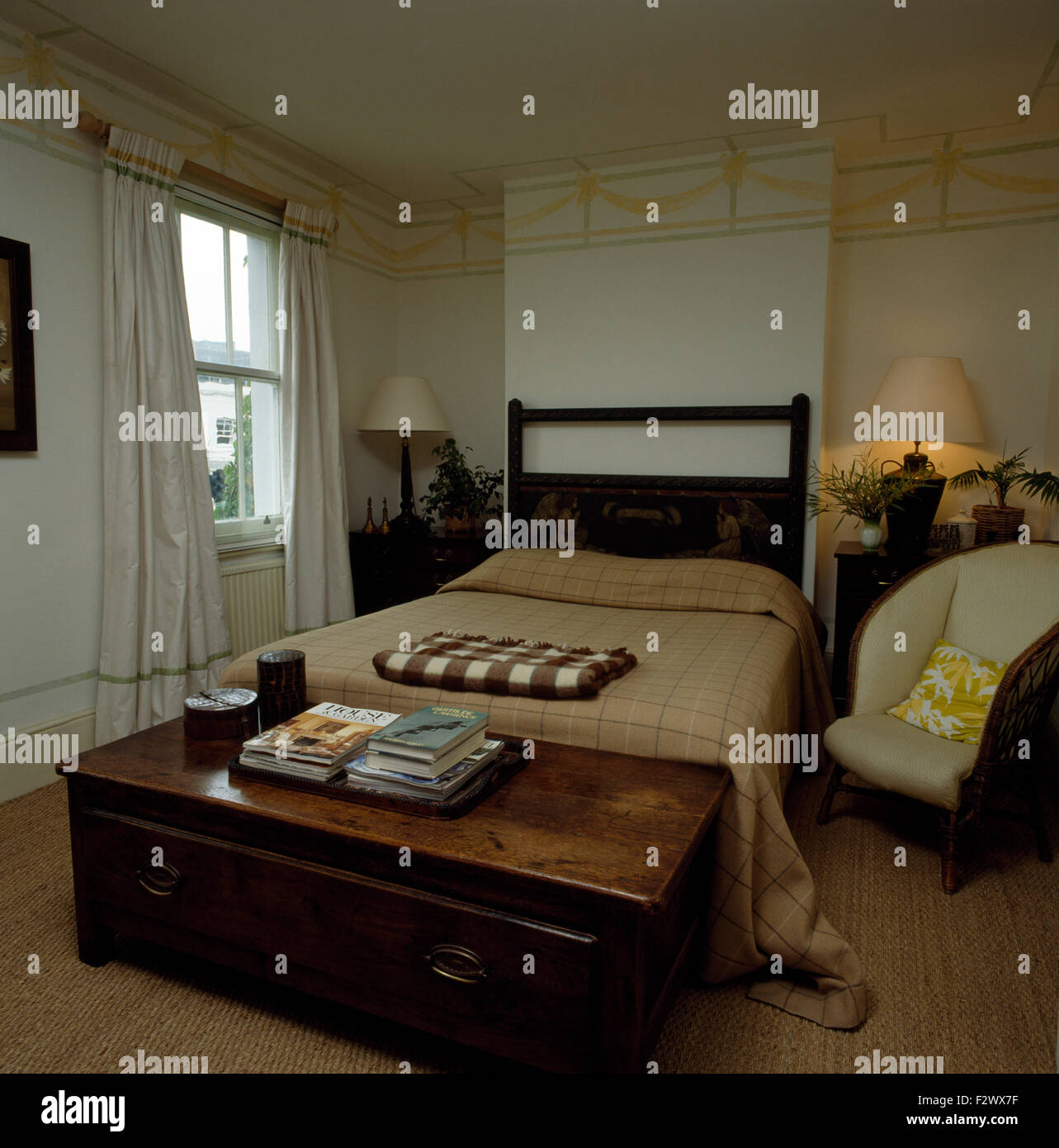 https www alamy com stock photo antique wooden chest at the foot of bed with beige bedcover in masculine 87850547 html