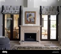 Painting above fireplace in modern Spanish living room ...