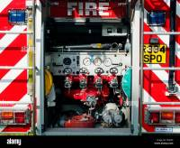Rear of a fire engine showing the water pump outlets and ...