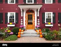 The front entrance and door of a house decorated for ...