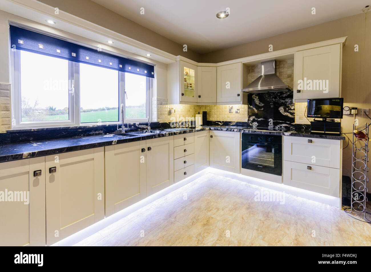 kitchen electrics aid gas cooktop stock photos images alamy modern with white units and under unit lighting image