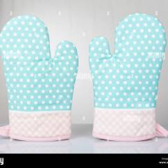 Kitchen Mittens Tables For Small Kitchens Oven Stock Photos Images Alamy Dotted Green Gloves Pair Pink Fabric Material White Spotted And Checkered