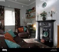 Original Edwardian cast-iron fireplace in nineties living ...