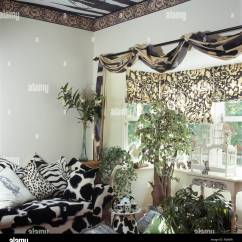 Animal Print Sofas Cheap Corner Sofa Under 300 Black White And Cushions In Nineties Living Room With Draped Fabric On Pole Above Window