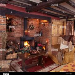 Country Living Rooms With Fireplaces White Leather Room Decor Wood Burning Stove In Inglenook Fireplace A Beamed Nineties Stock An Oak Coffee Table Beside Armchair