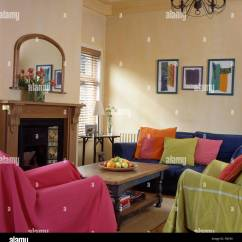 Green Cushions Living Room Glider Pink And Lime Throws On Chairs In Economy Style Nineties With Colorful A Blue Sofa