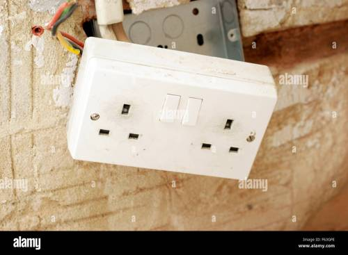 small resolution of electric plug sockets with exposed wiring in a rented social housing property house that needs attending to