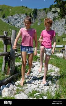 Germany Bavaria Lenggries Two Girls Walking Barefoot