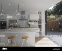 Kitchen and with sliding door to garden in UK home Stock ...