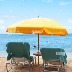 Beach Chairs And Umbrella Cheap Wedding Chair Covers Towel Stock Photos Lawn On Image