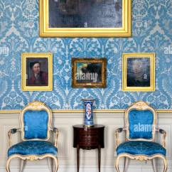 Blue And White Upholstered Chairs 1950 Formica Table Gold A Wall Of Paintings Interior Rundale Palace In Latvia