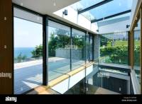 The interior of a modern house on the coast. Large sliding ...