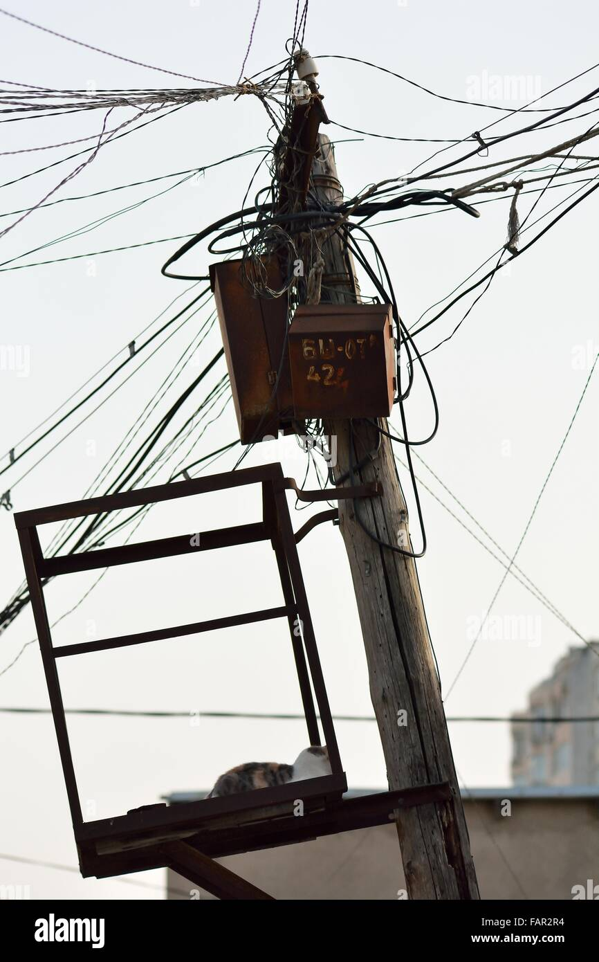hight resolution of messy telecoms cables in baku capital of azerbaijan telephone wires are untidy at a pole tangled and sprawling