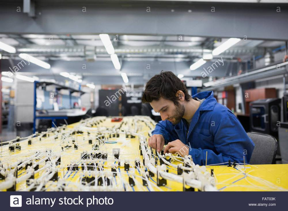 medium resolution of helicopter technician repairing wiring harness stock image