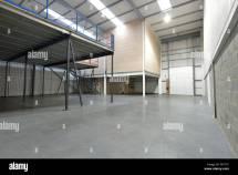 Interior View Of Empty Warehouse And Mezzanine Floor Stock