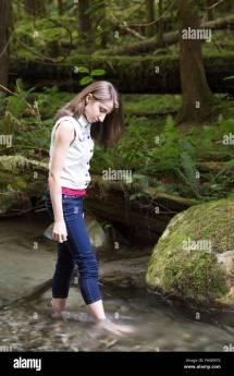 Teenage Girl Walking Barefoot In Stream; Chilliwack