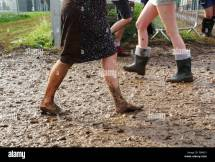 Woman Walking Barefoot in Mud