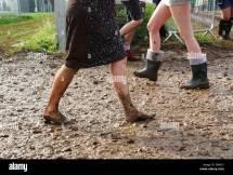 Woman Walking Barefoot in Mud