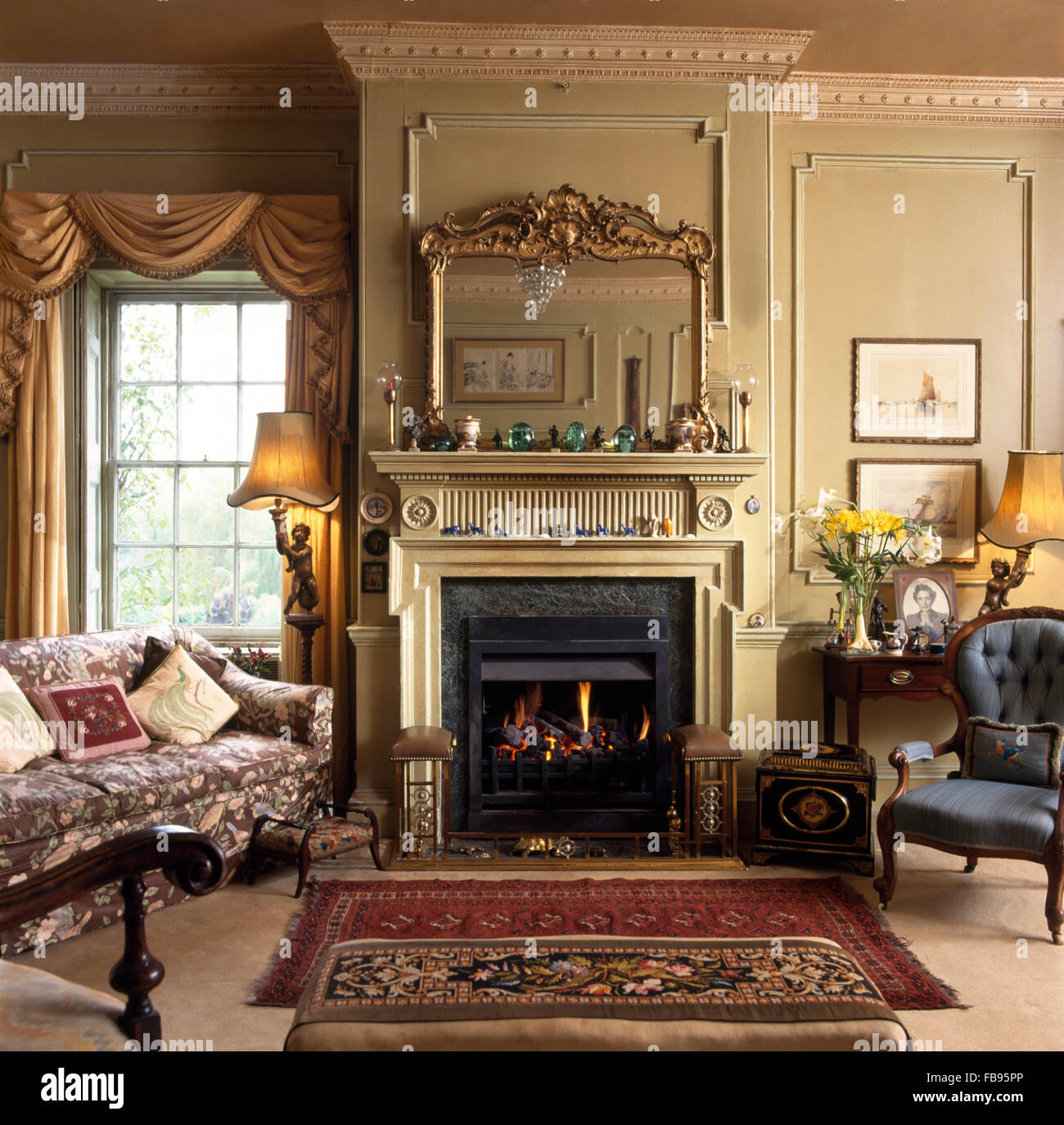 Antique mirror above fireplace in Georgian living room