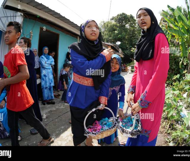 Young Malay Girls Distributing Sweets For Kids At The Malay Wedding Party Malaysia