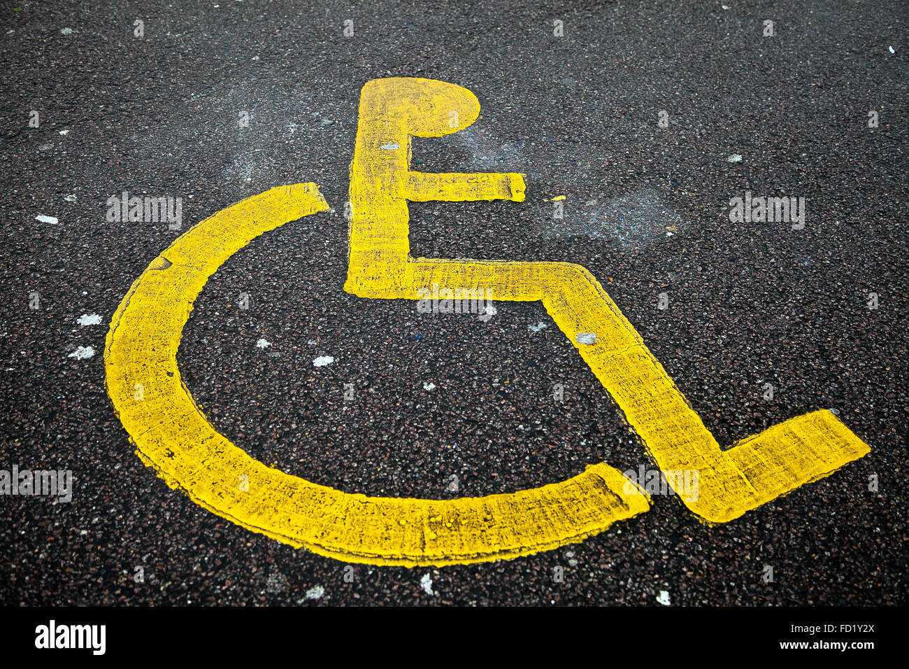 yellow wheelchair best chair after lower back surgery sign on road stock photos painted icon of in a disable parking bay image