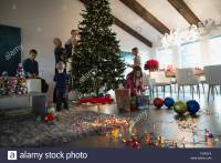 Family decorating Christmas tree in living room Stock ...