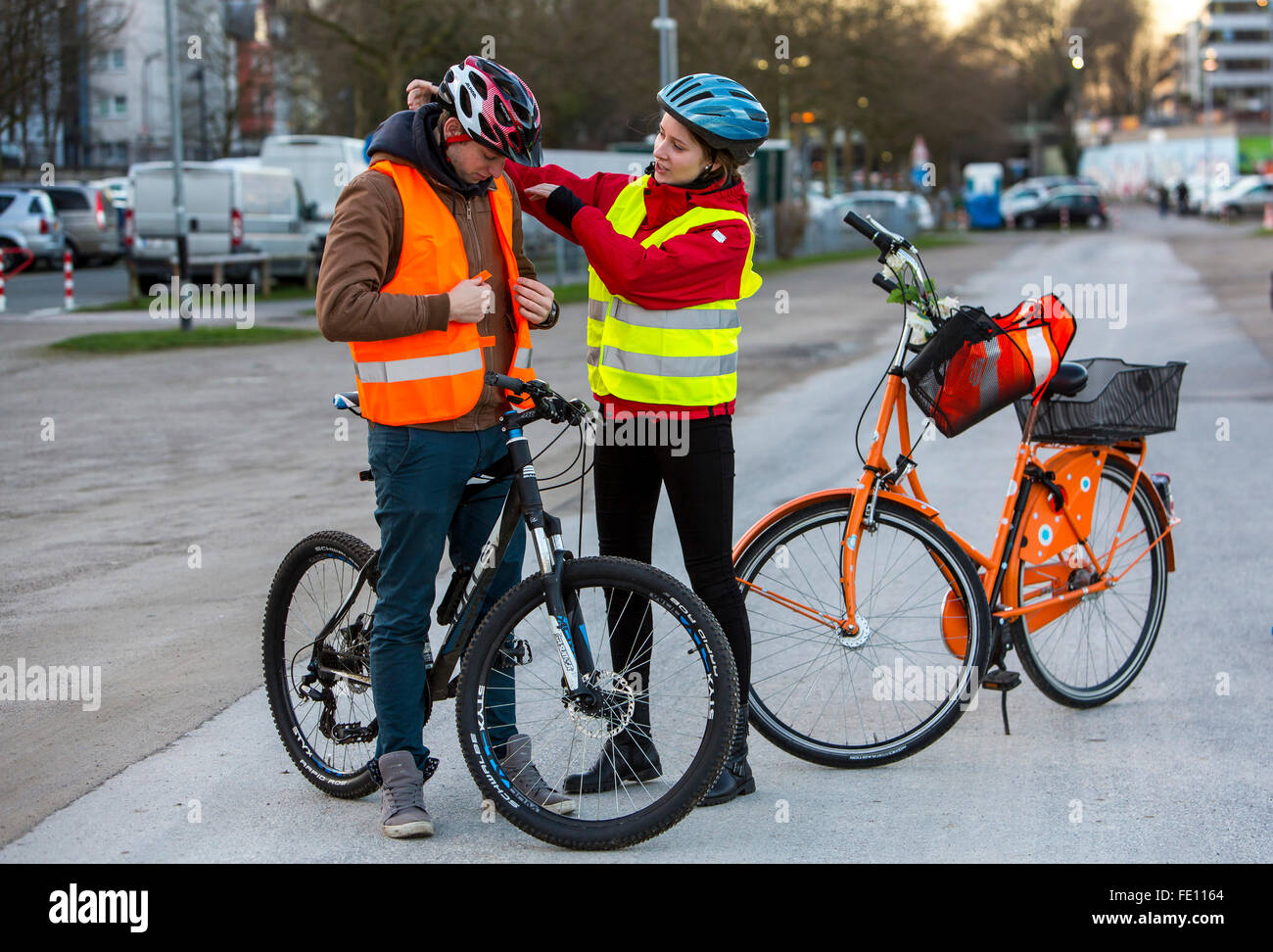 Cyclist Put On Safety Clothing Bike Helmet And Reflecting