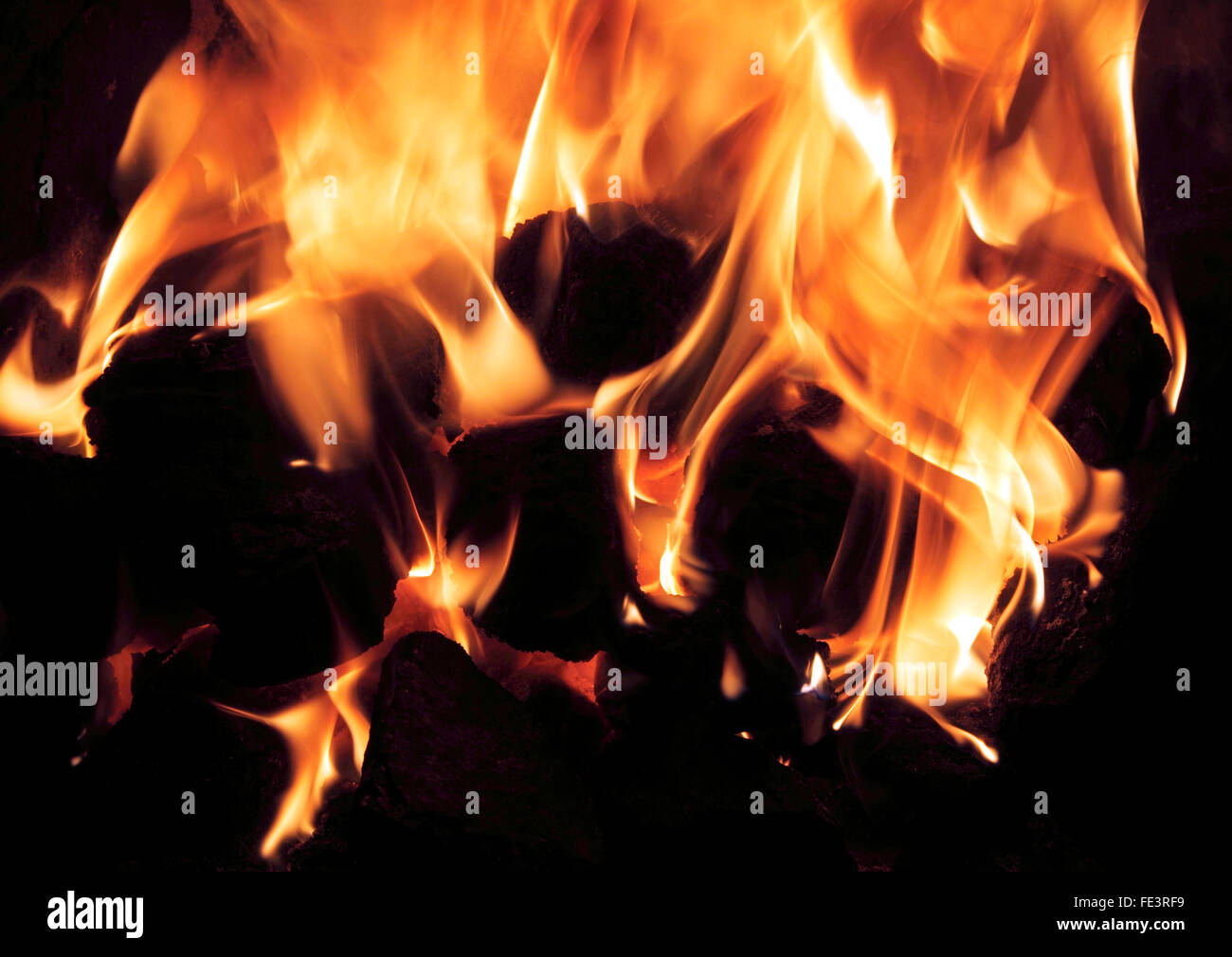 hight resolution of domestic coal fire burning in hearth home heat heating energy fuel carbon emission flame flames