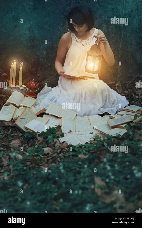 Beautiful Woman Reading Books In Dark Forest. Surreal