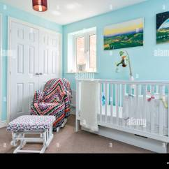 Blue Nursery Chair Design Gif Stock Photos Images The Of A Young Child Decorated In White With Cot And Nursing
