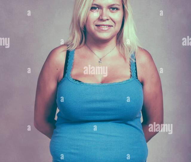 Portrait Of A Young Chubby Blond Woman Smiling Stock Image