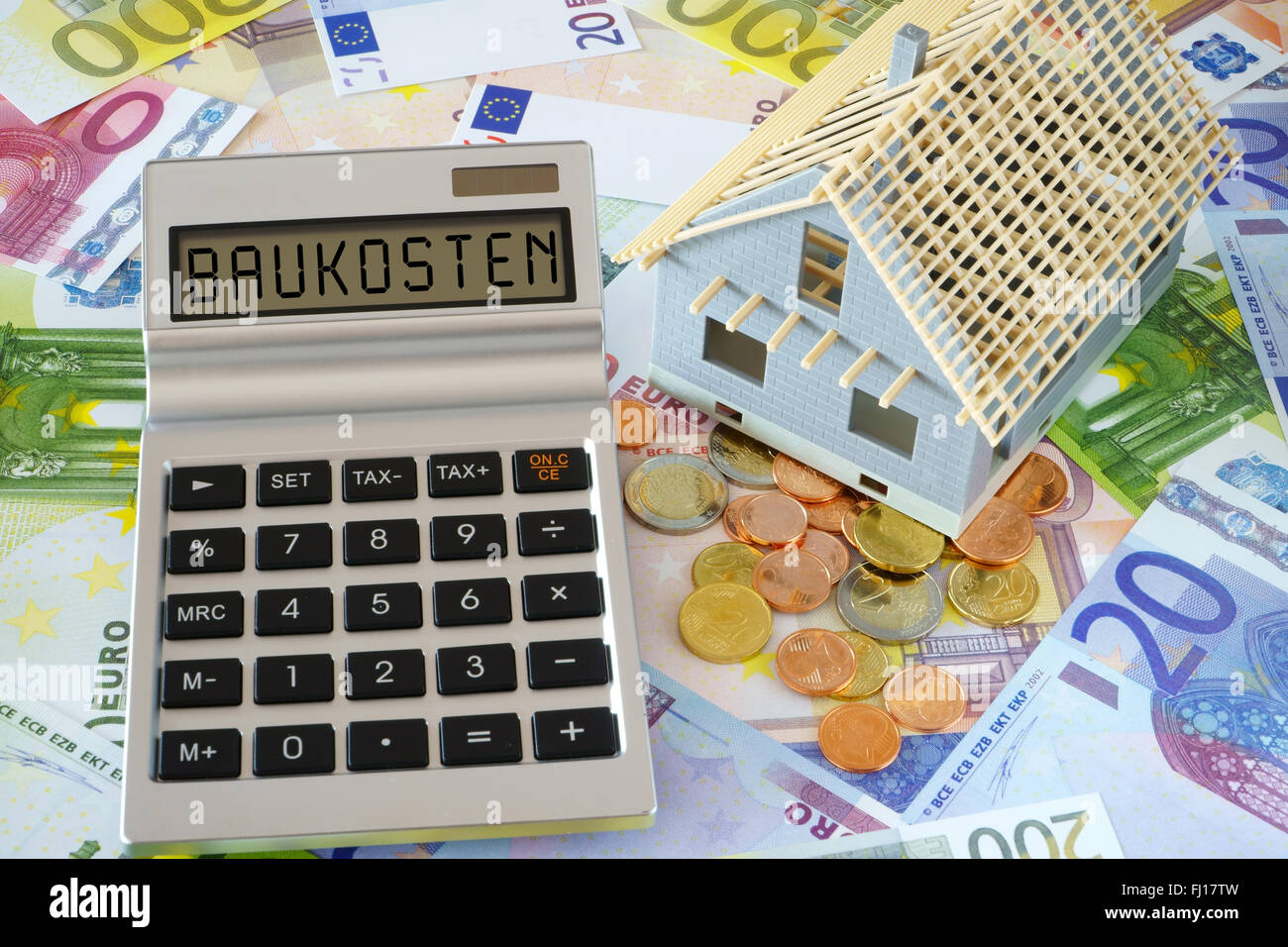 English Money And Calculator Stock Photos & English Money And