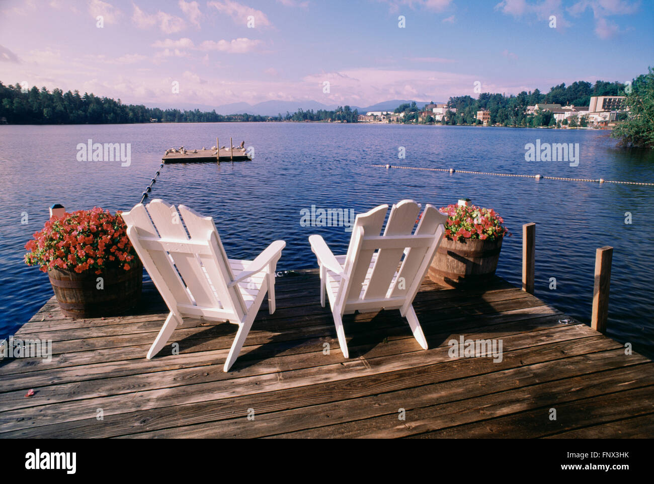 new river adirondack chairs rustic wood dining dock stock photos and