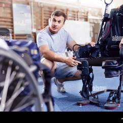 Wheelchair Equipment Beach Chairs At Walgreens Woman Weight Stock Photos Physical Therapist Explaining To Man In Image