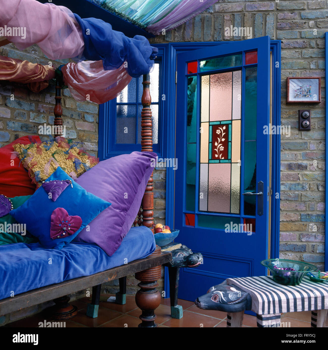 living rooms indian style ideas to decorate my small room velvet cushions on sofa in nineties with a stained glass panel bright blue door