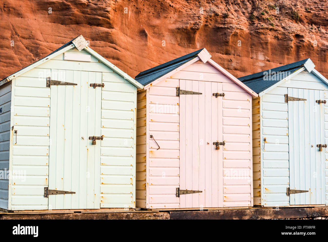 Beach Hut Row In Pastel Colors Red Rock Background South