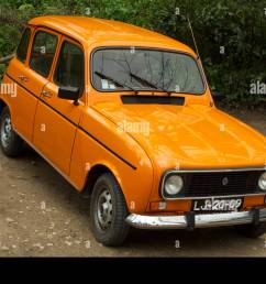 a classic orange renault 4 [ 1300 x 951 Pixel ]