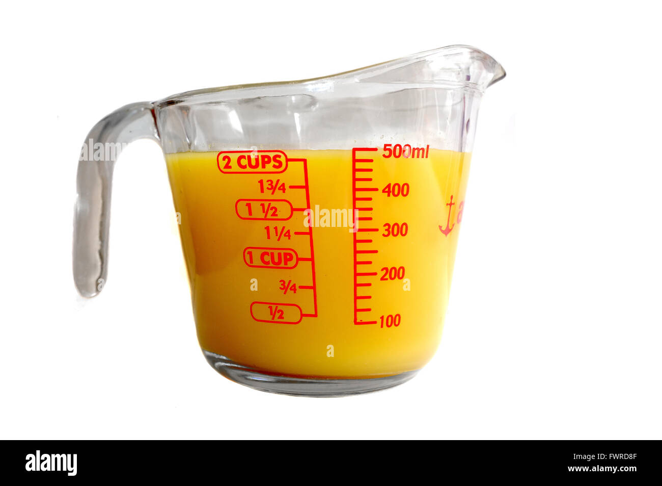 A Pyrex Measuring Jug Full Of Orange Coloured Liquid