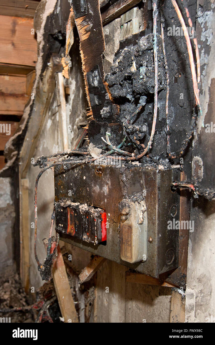 medium resolution of a fusebox in a house which caught fire due to a power surge stock