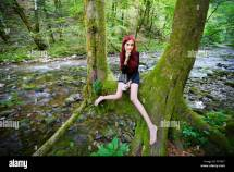 Red-haired Young Woman Barefeet In Forest Breakfast With