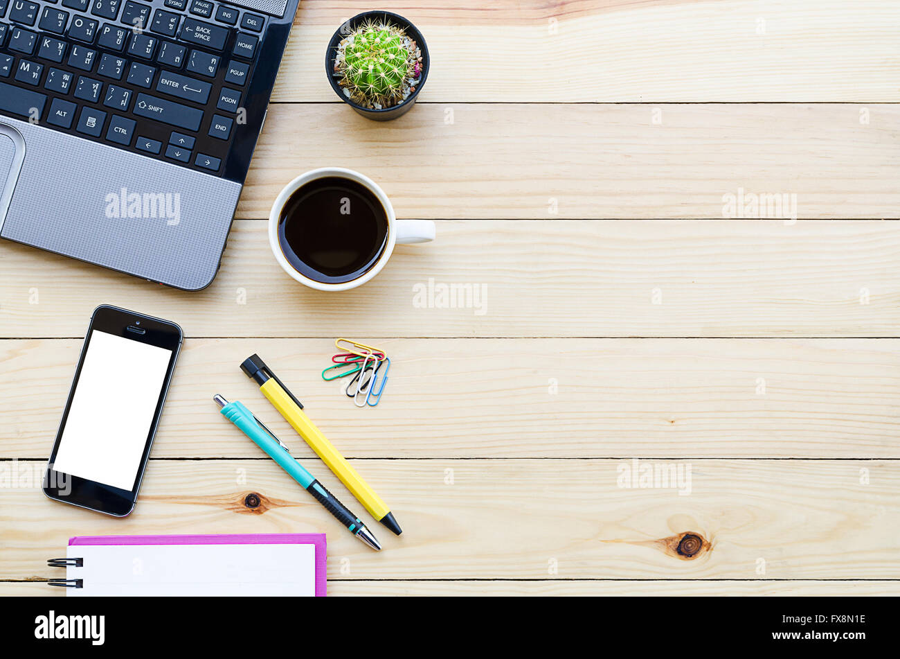 https www alamy com stock photo office desk table with laptopsmartphone coffee cup penpencil and notebooktop 102225018 html