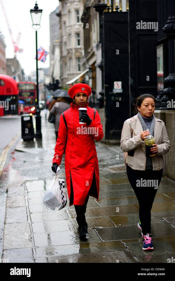 Woman In Red Coat And Hat With Coffee Walking Rain Stock Royalty Free