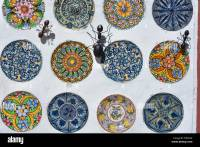 Display of hand-painted ceramic plates and metal ants ...