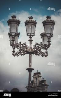 traditional street lamp with decorative metal flourishes ...
